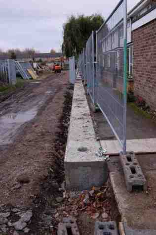Base of flood wall: an aluminium barrier can be fixed on top when needed