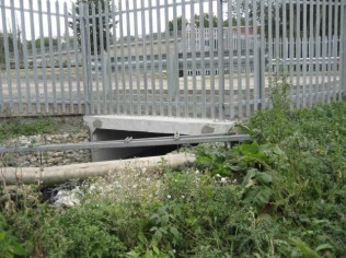 Replaced by one much larger box culvert (scales not same between the two photographs)
